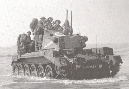 Crusader AA MKIII (from the radio aerial on the front of the hull) landing on Gold Beach, Normandy