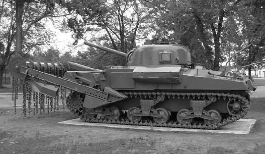 "Sherman Flail or ""Crab"" tank, for clearing a path through minefields and barbed wire, too."