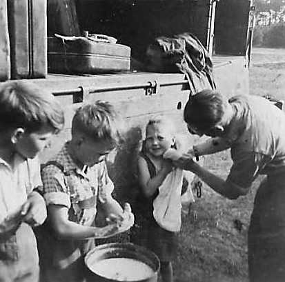 There were dirty children everywhere who slept where they could. There was no soap, no working bathrooms so Driver Ken Pitt and some of the others who had children gave some of them a scrub and whatever else they could spare from their rations.