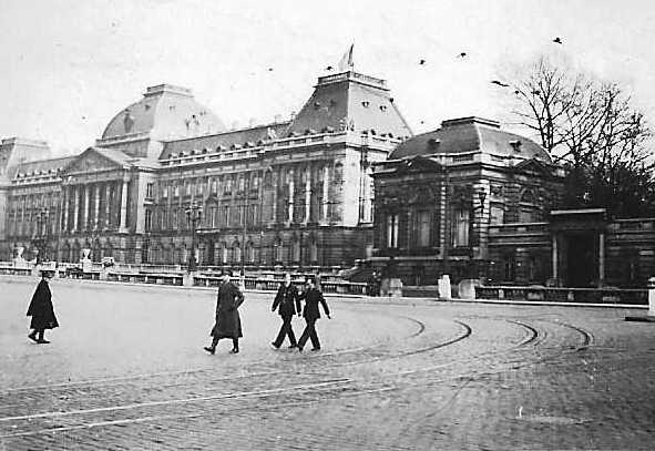 Servicemen go about their daily life in the ruins of the city in front of the ruined Reichstag,