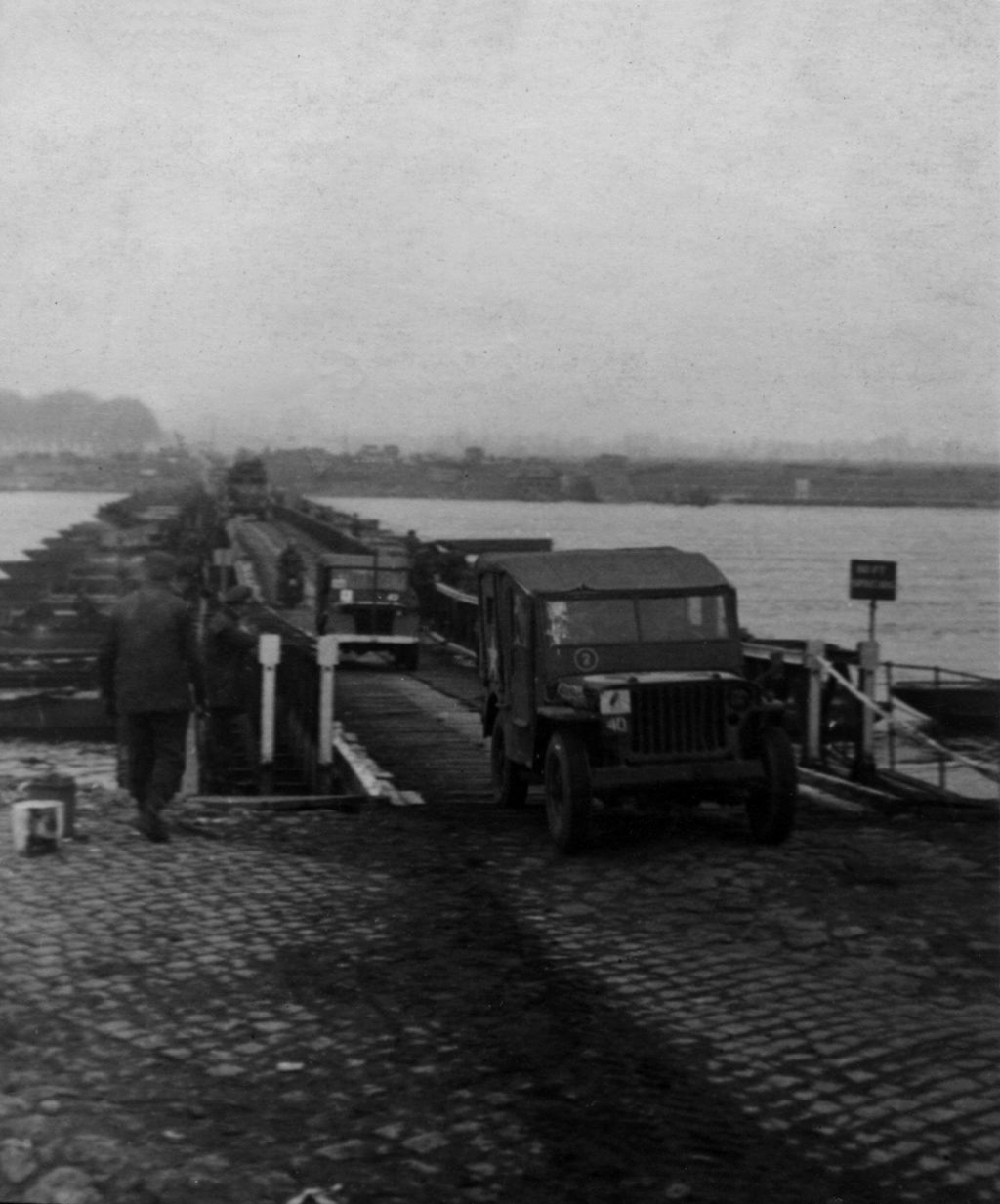 Divisional HQ Jeeps crossing ther bridge.