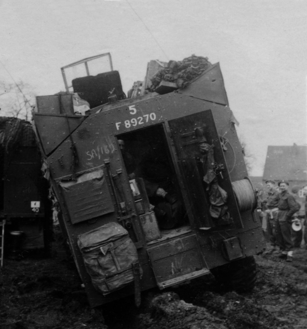With a Division HQ vehicle behind it (AoS 40), No 5 command vehicle, denoting Divsional REME, stuck in some mud. The Divisional Artillery vehicle was No 3.