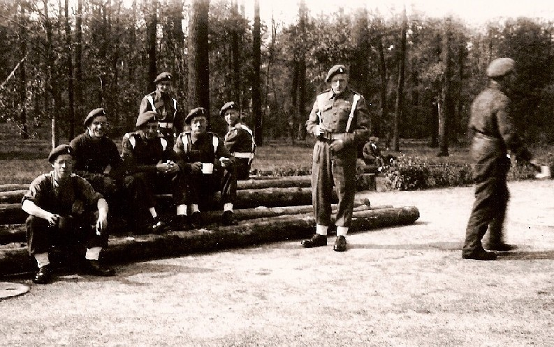 Men of K Battery, 5 RHA, relaxing on some logs before the Berlin Victory Parade. Courtesy of 'Jock' (Rob) Lerche (K Bty) and Barry Forbes.