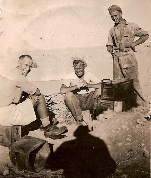 Men from K Battery, 5 RHA, with an improvised oven made out of old Ammunition boxes, cooking in the desert, September 1942.  L - R: Bdr Colin Tovey (TOSKA), L/Bdr Lesley Vince, L/Bdr Bob Lerche (JOCK).  Courtesy of 'Jock' (Rob) Lerche (K Bty) and Barry Forbes