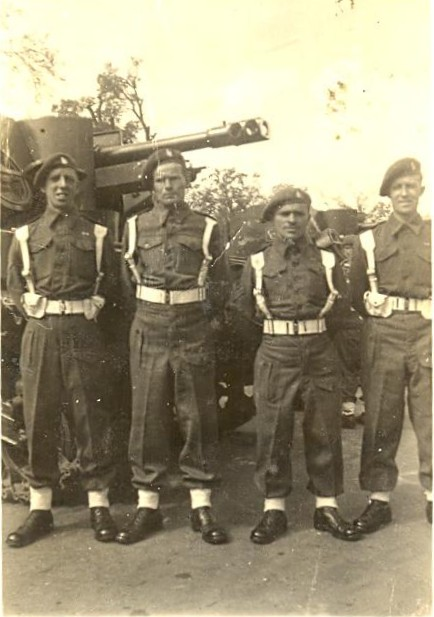 The crew of a Sexton from H Troop, CC Battery, 5 RHA, preparing for the Victory Parade in July 1945.  Second from left in the photo is Leonard Smith and the photograph is courtesy of his family.