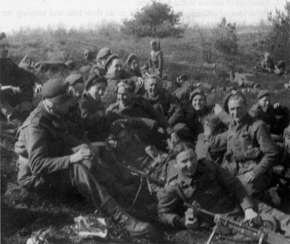 Men from 1st Bn. Rifle Brigade, resting between engagements in Holland 1945