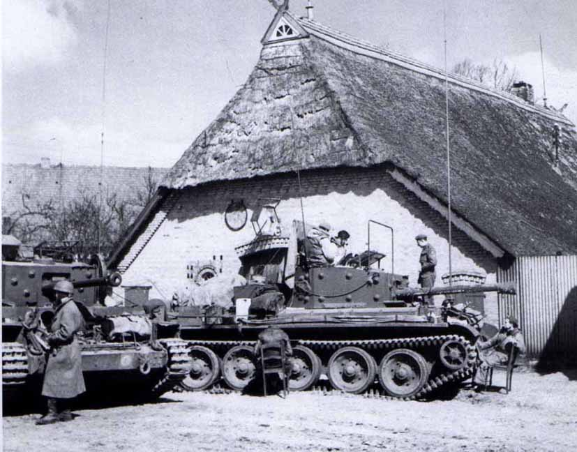 Command Tanks from 22nd Armoured Brigade TAC HQ, distinguihable by the very long aerials. They are at Syke outside Bremen, April 1945. The nearest man in the turret is Major Pat Fitzgerald (R.Signals) and the other is believed to be Major Joe Leaver (RTR) the Brigade Major. The man standing on the tank is Sgt 'Wisey' Wiseman, (R.Signals)