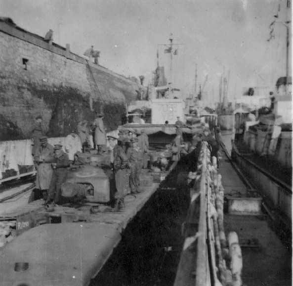 Loading tanks and equipment of the Brigade at Felixstow, June 1944. Photographer David Beaven courtesy of Ian Beaven.