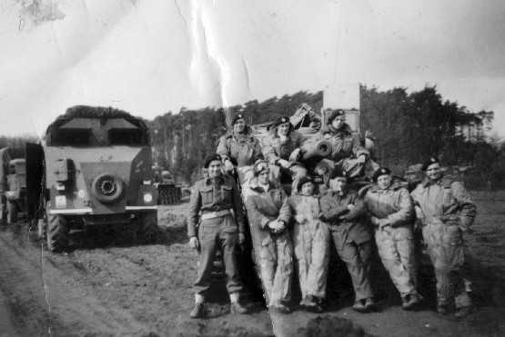Men of HQ Protection Troop with the Brigade Armoured Command Vehicle in the background, after having crossed the Rhine. Photographer David Beaven courtesy of Ian Beaven.