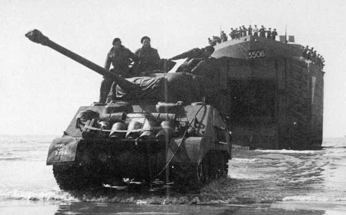 A Sherman Firefly landing on 7th June 1944, from the same LST as the Crusade AA tank above right