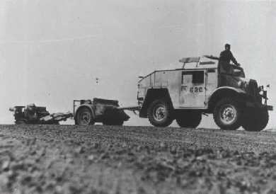 Quad Tractor, Limber and 25pdr gun, of 4th RHA, on the move in 1942.