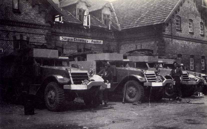 Half Tracks and men of 65th Anti-Tank Regiment (Norfolk Yeomanry) outside a German Pub.