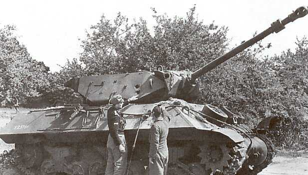German Troops inspecting an Achilles (M10 17 pdr) Tank Destroyer from 260 Battery, 65th Anti-Tank Regiment (Norfolk Yeomanry) after the battles at Villers-Bocage and the Brigade Box. Only 260 Battery were equipped with the 17 pdr version at this time with the other SPG Battery (258) having US 76mm M10 Tank Destroyers.