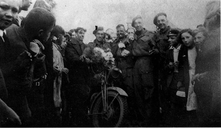 Men of 67 Company RASC and locals in Hebeaux, after its liberation in 1944.