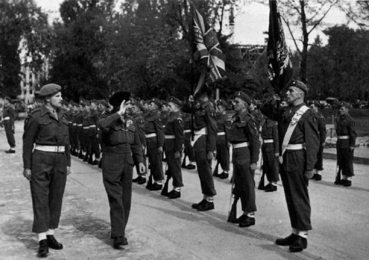 Honour Guard from 'B' Company, 9th Durham Light Infantry being inspected by General Montgomery during the Victory Parade.