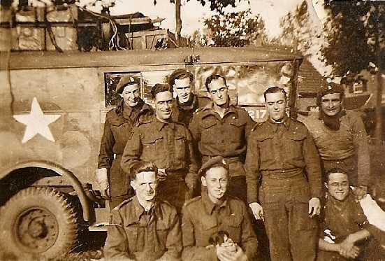 Men from CC Battery (most likely from 'H' Troop), 5 RHA, Europe 1944 or 1945, with a well laden lorry behind them. Courtesy of William Parfitt & Mark Smith.