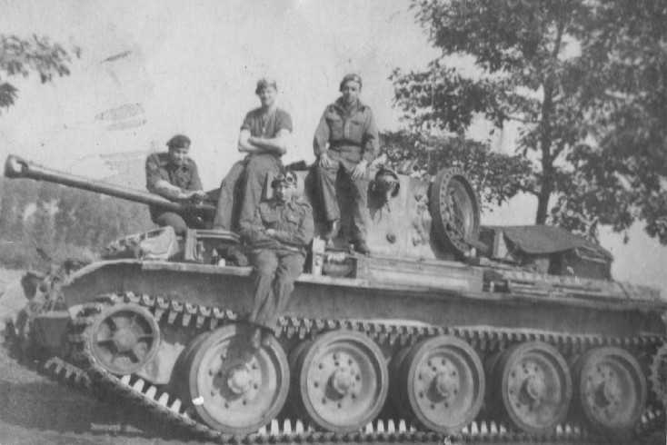Brigade Protection Troop Cromwell called 'Nebby' and its crew near Eindhoven 1944. Photographer David Beaven courtesy of Ian Beaven.