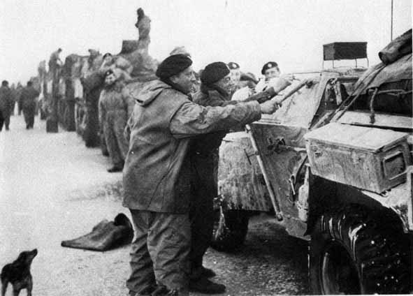 Painting 'Snow' camoflague of a Scout car ready for Operation Blackcock