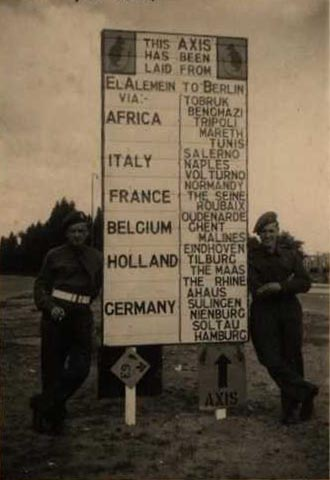 Signaller Len Cosford (right) and his friend John with the Div HQ Sign Post Berlin 1945. Courtesy of Len Cosford and his Daughter Pam Morris.