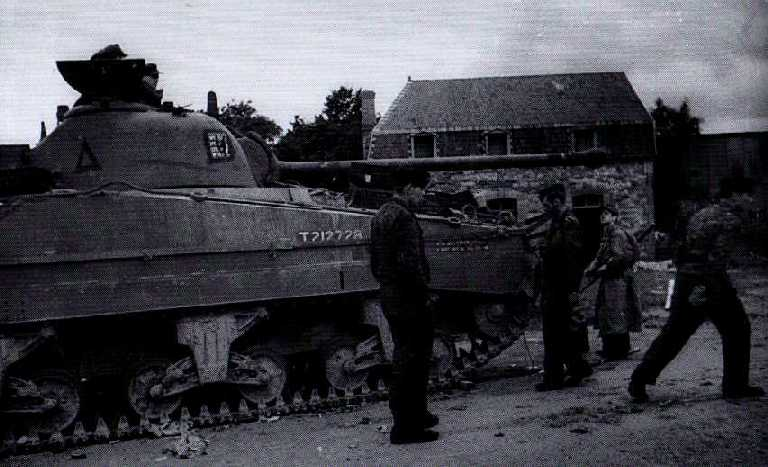 Germans inspecting a Sherman Firefly of A Squadron 4 CLY