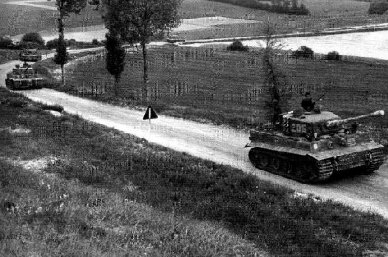 II Kompanie, 101 SS Panzer on their way to Normandy. Tank 205 is reported to be that of Michael Wittman