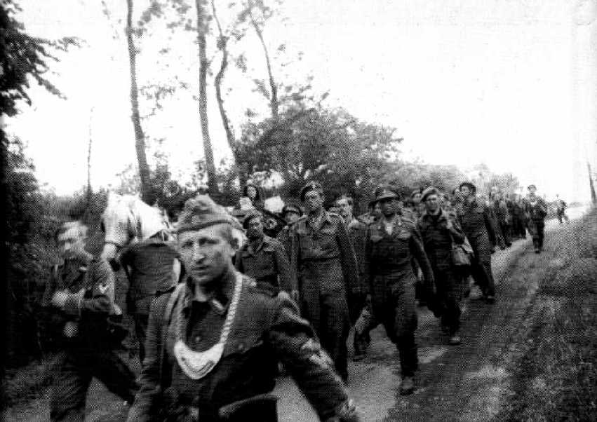 Men captured at Villers-Bocage on their way to captivity