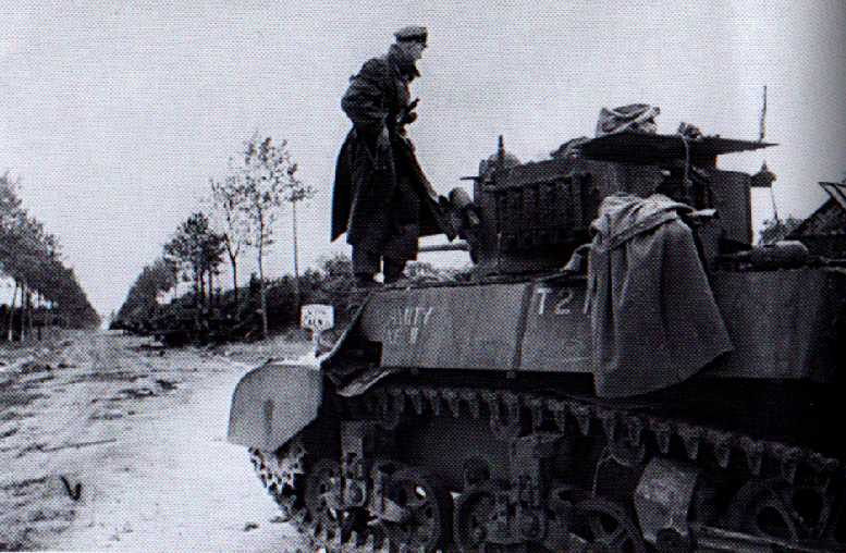 Germans inspecting a Stuart from the Recce Troop just outside Villers-Bocage